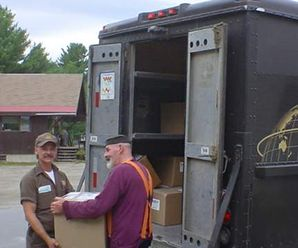 Charlie and Bob from Brown loading up the day's work to travel from Kingfield to all over the country